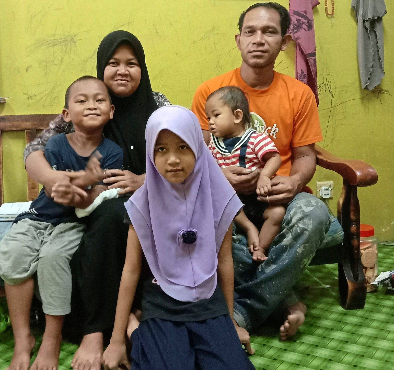 The surgery will enable Nur Syiffa (front) to lead a normal life.