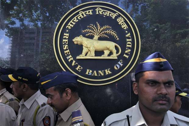 India's central bank surprises by keeping rates unchanged, slashes growth forecast