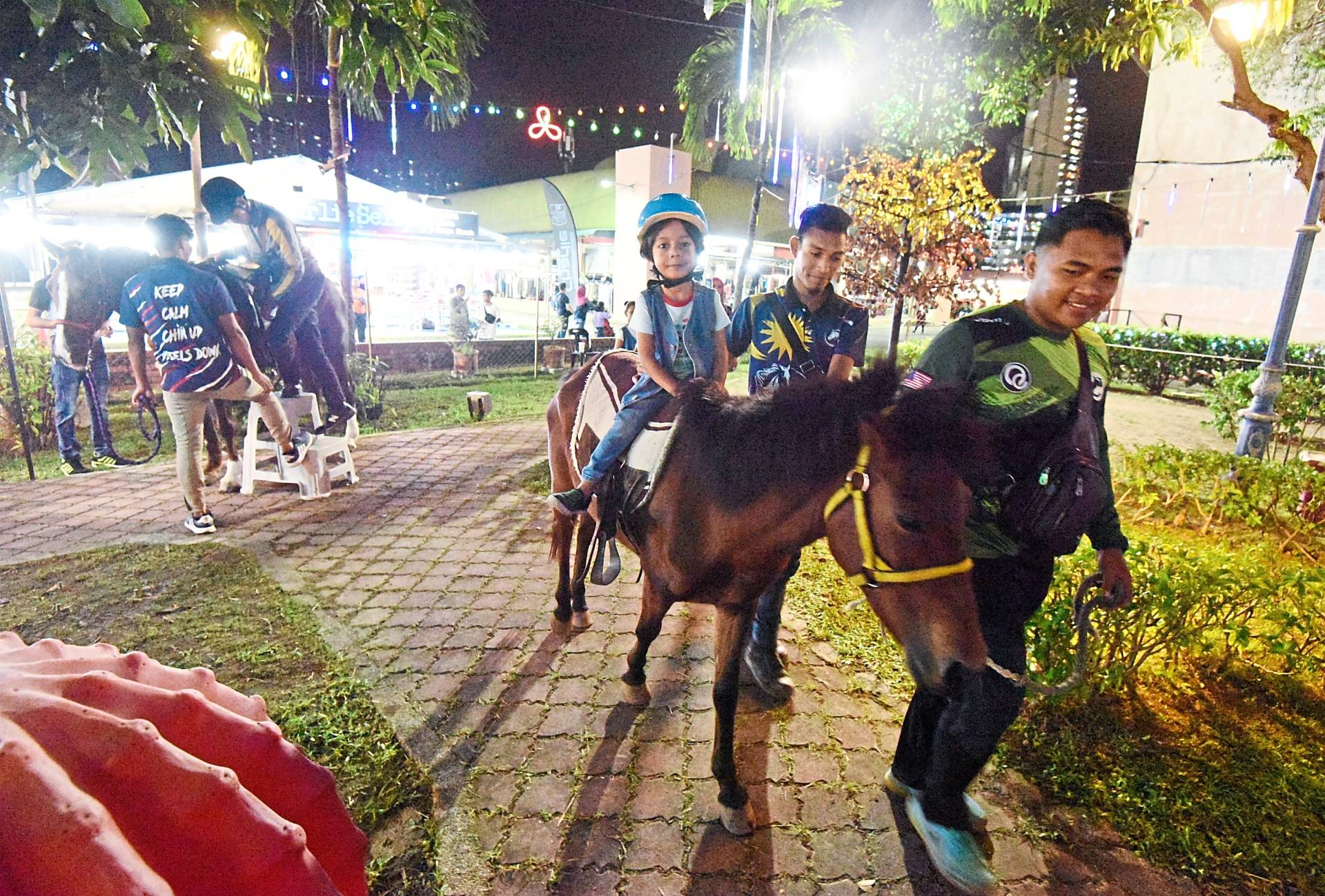 Horse riding is a hit among younger children while the many (above) amusement rides are attracting children and youths.