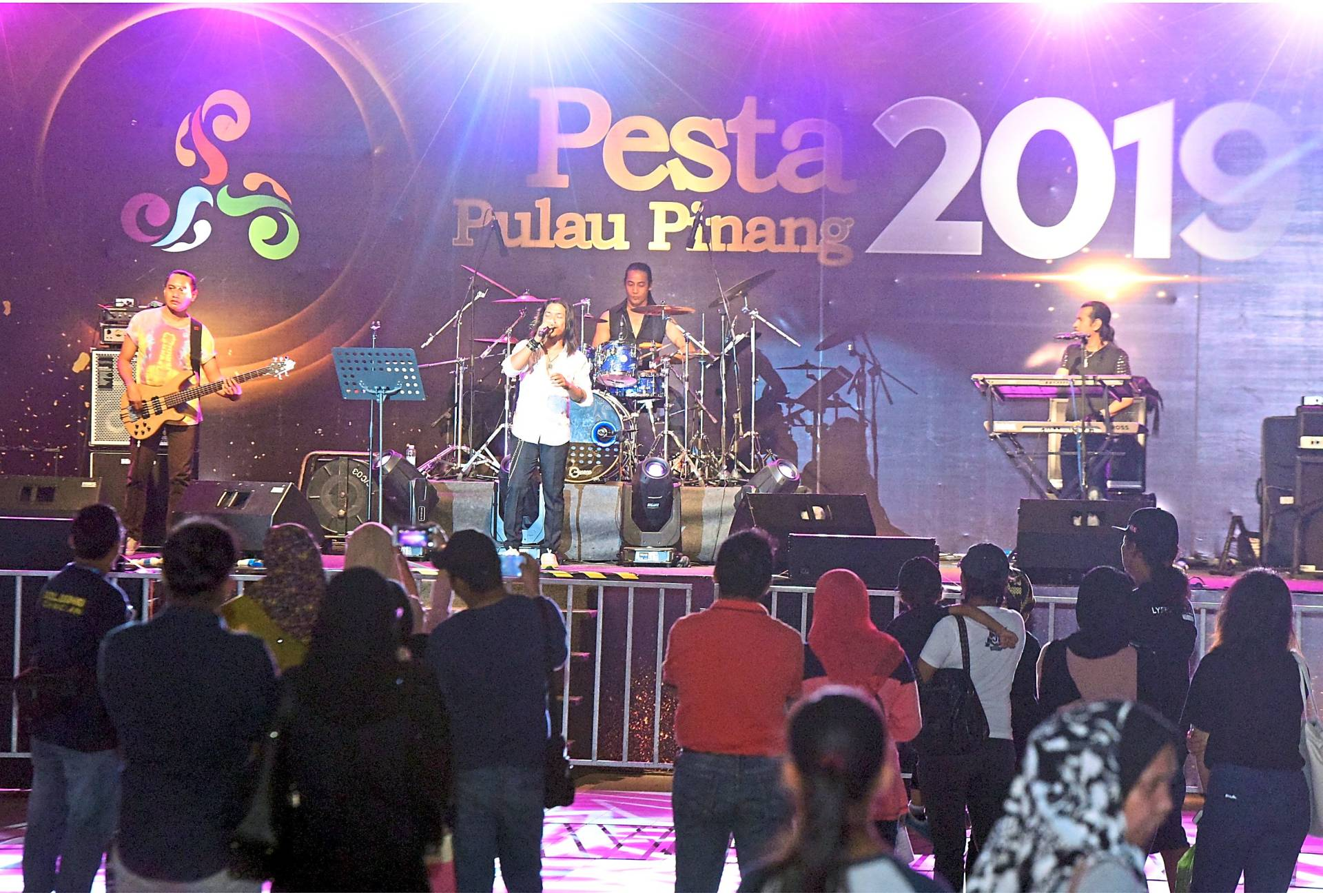 A local band performing on stage at the pesta site.