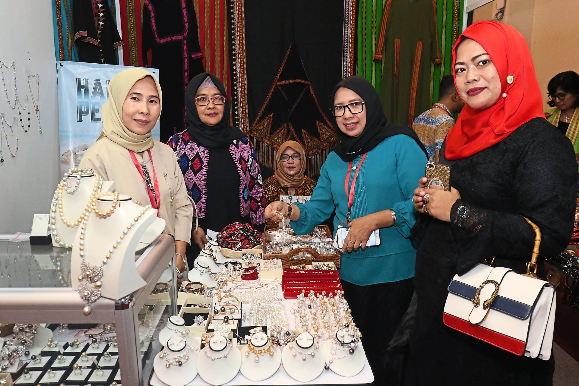 Nur Janah (left) attending to visitors interested in her pearl jewellery.