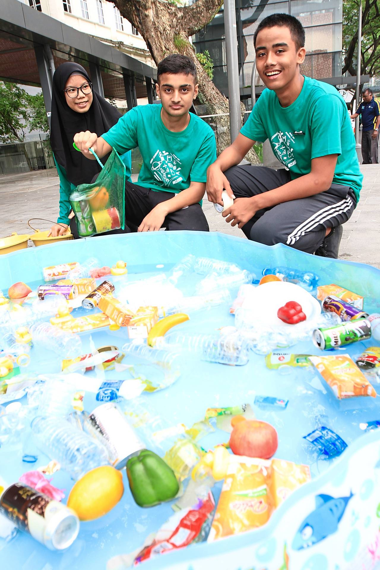 Yayasan Chow Kit children showing the environmental-themed game of fishing for litter.