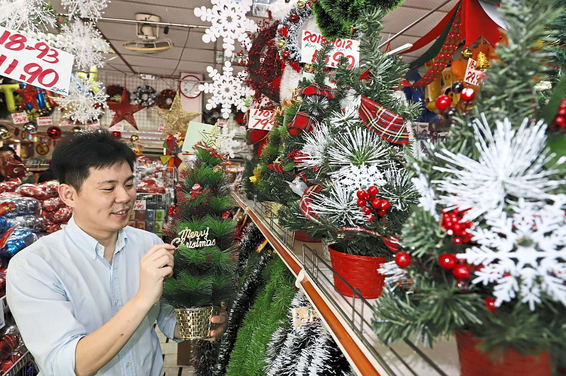 Goh checking out the Christmas decorations for his office