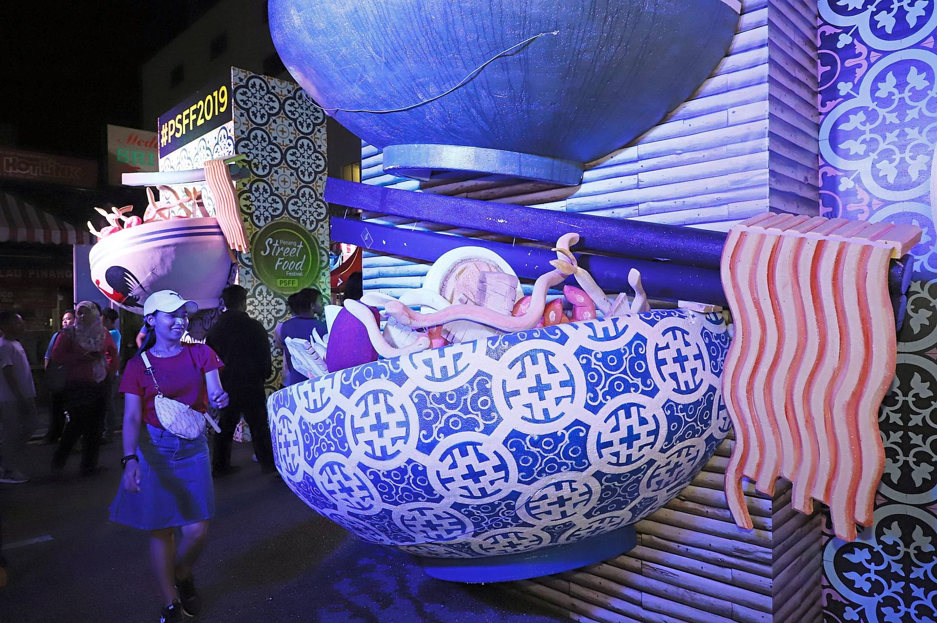 Sculptures of giant-sized bowls of noodles make interesting backdrop for selfies at the entrance to the Penang Street Food Festival 2019.