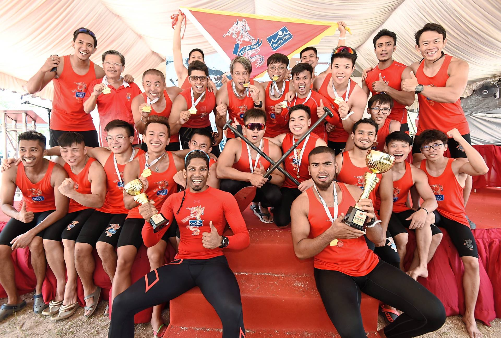 Pacific West Dragon Boat Club members in jubilant mood after their successful outing.