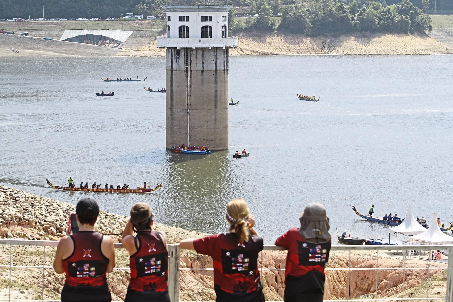 Participants watching the dragon boat races at the Teluk Bahang Dam.