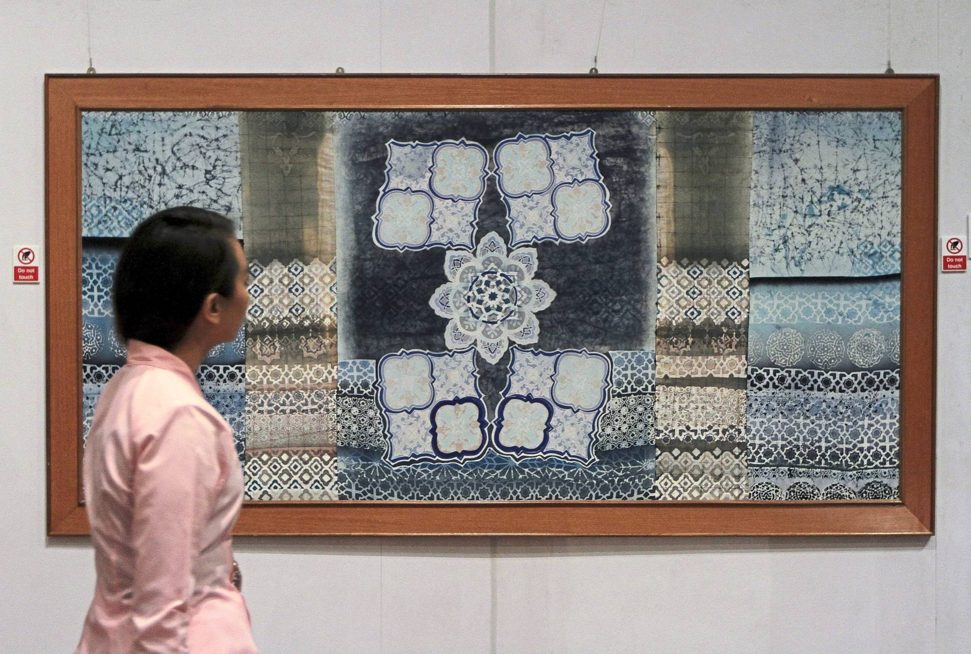 An exhibit featuring ferns and flower motifs created by a hand-drawn technique on cotton fabric. Photo: The Star/Yap Chee Hong