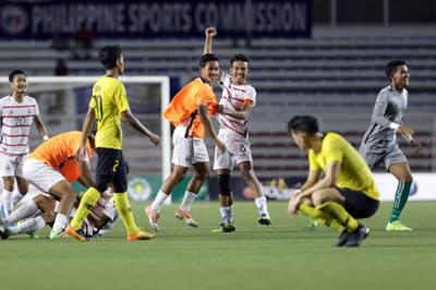 Cambodia players celebrating after defeating Malaysia 3-1 in the Group A match at the Rizal Memorial Stadium in Manila, December 4, 2019. It was Malaysia\'s first defeat to Cambodia in SEA GAmes history. IZZRAFIQ ALIAS/The Star