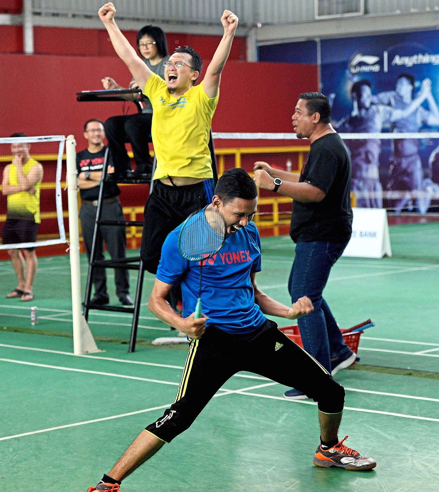Bank Rakyat players celebrating after their victory in the badminton doubles against Alliance Bank Malaysia Bhd.