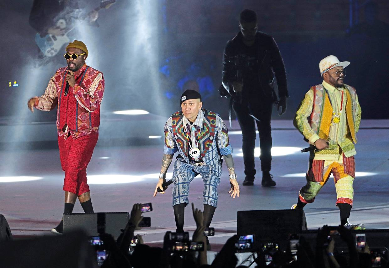 Main act: American hip-hop group Black Eyed Peas performing at the closing ceremony.