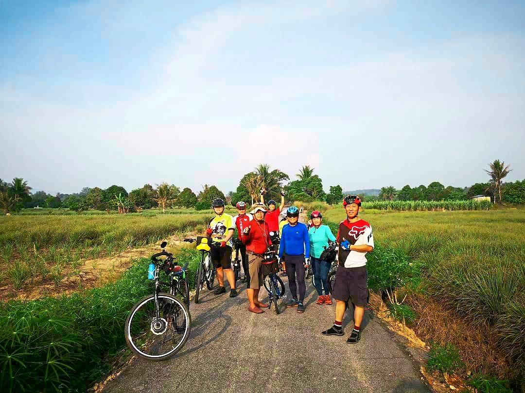 Cycling is not out of reach for seniors as long as they are reasonably fit and up for an adventure, says Poon (in light blue) with some of her travel buddies.