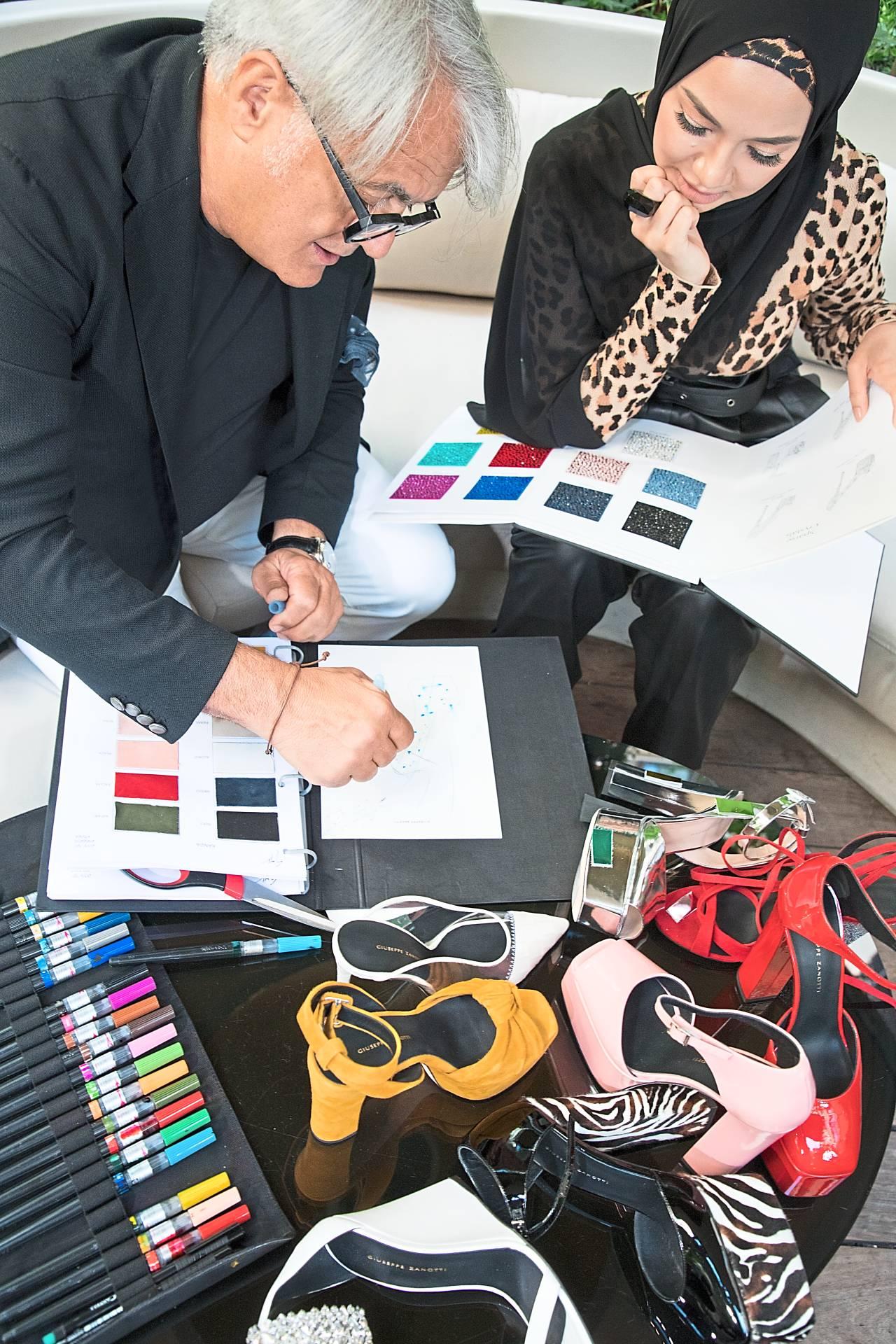 Giuseppe Zanotti and Neelofa brainstorming in Paris on the designs.