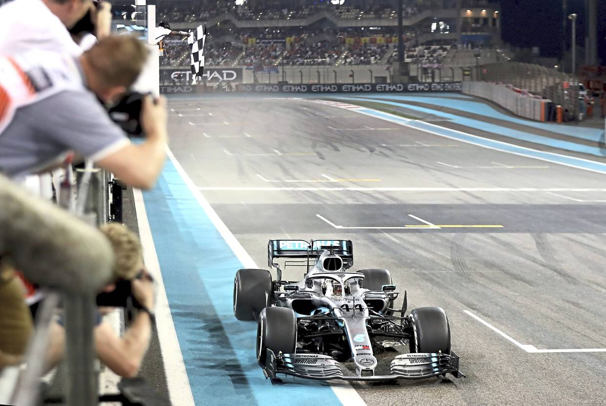Mercedes AMG Petronas driver Lewis Hamilton crosses the finish line to win the Emirates Formula One Grand Prix at the Yas Marina racetrack in Abu Dhabi recently.