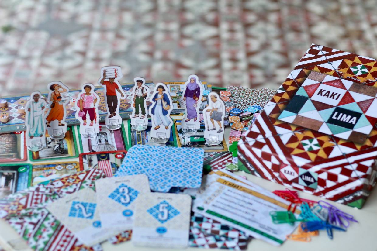 The illustrations of the game, from the scoreboard to the characters, were all based on actual people in George Town and kaki lima tiles. Photo: Kaki Lima