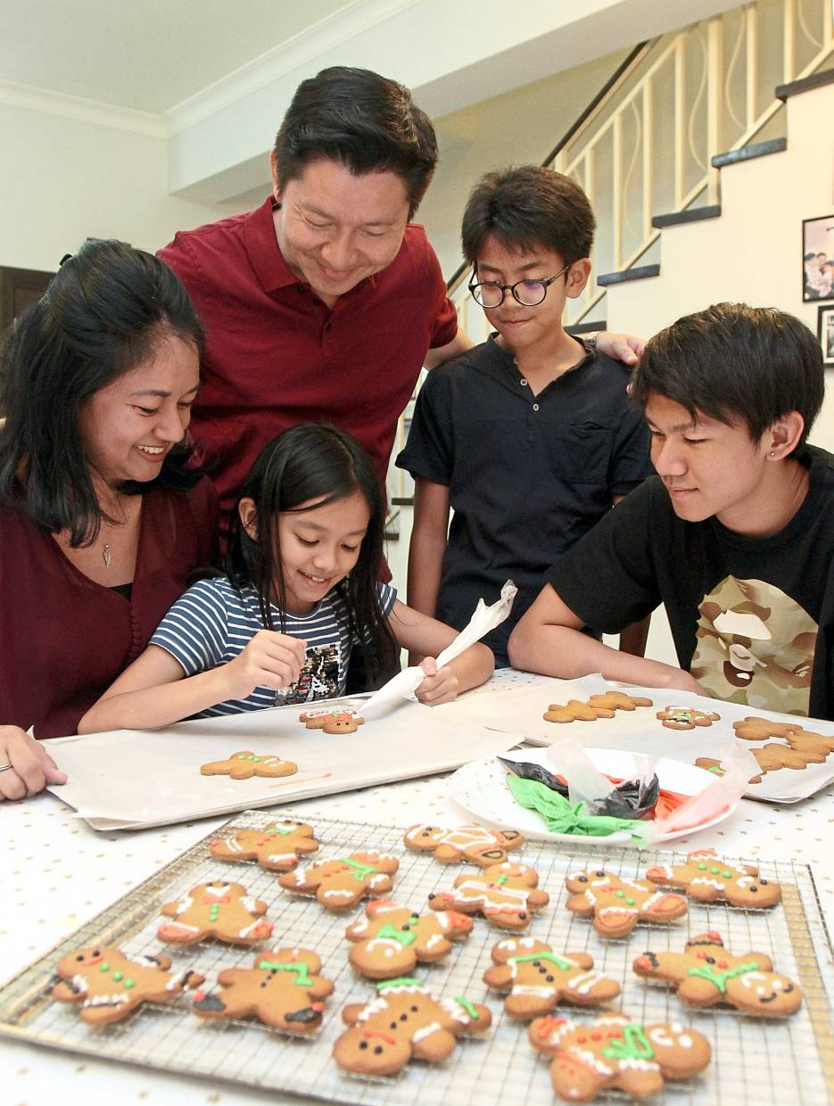 Nunis and her kids typically make gingerbread men cookies together every Christmas. (From left) Joanne, Leann, Shawn, Luke and Ryan.