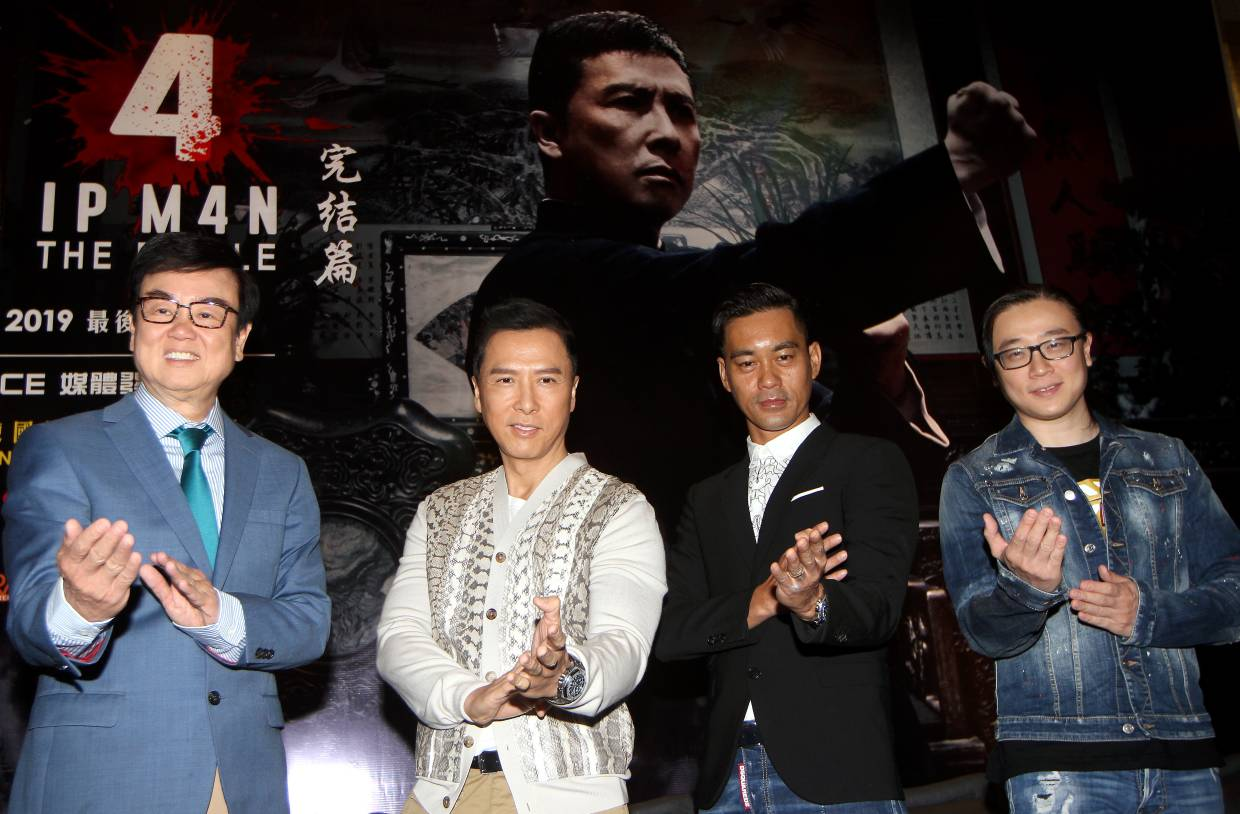 The cast and crew of 'Ip Man 4: The Finale' in Kuala Lumpur recently, (from left) producer Raymond Wong, star Donnie Yen, co-star Danny Chan and screenwriter Edmond Wong. Photo: The Star/Muhamad Shahril Rosli