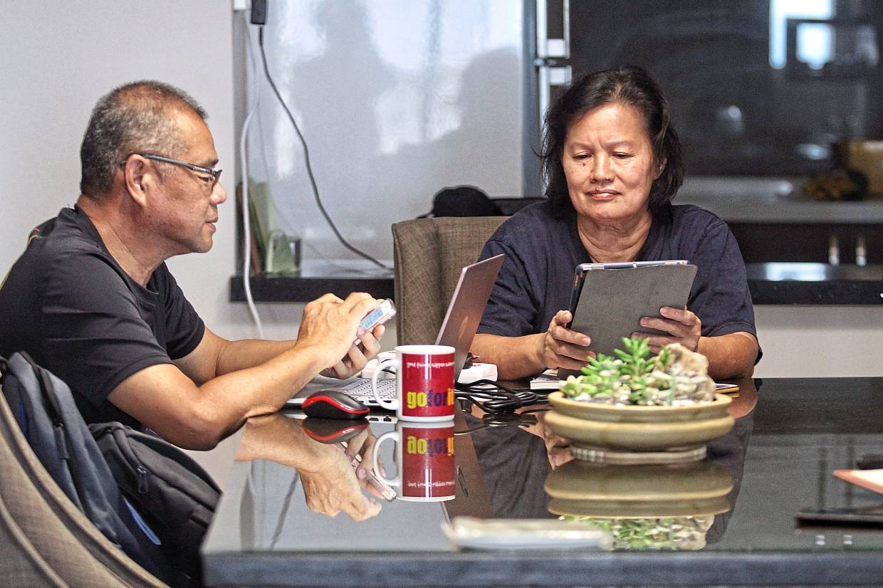 Lioh (left) and Yea sometimes communicate via WhatsApp even when they are both at home at the same time. — SAM THAM/The Star