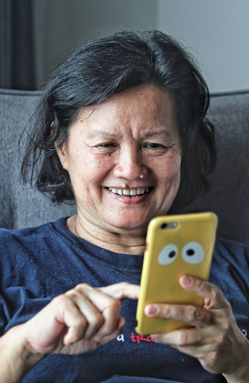 Yea has over 900 friends on her Facebook account and spends about six hours every day looking at their postings. — SAM THAM/The Star