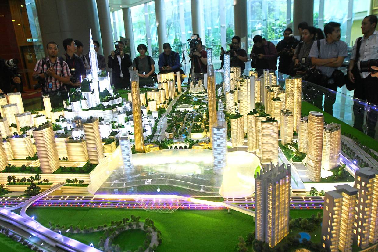 Clarity needed: People viewing a model of Bandar Malaysia project. Once the market has more clarity on the different phases and timelines of the development, then perhaps it will be easier to identify the beneficiaries.