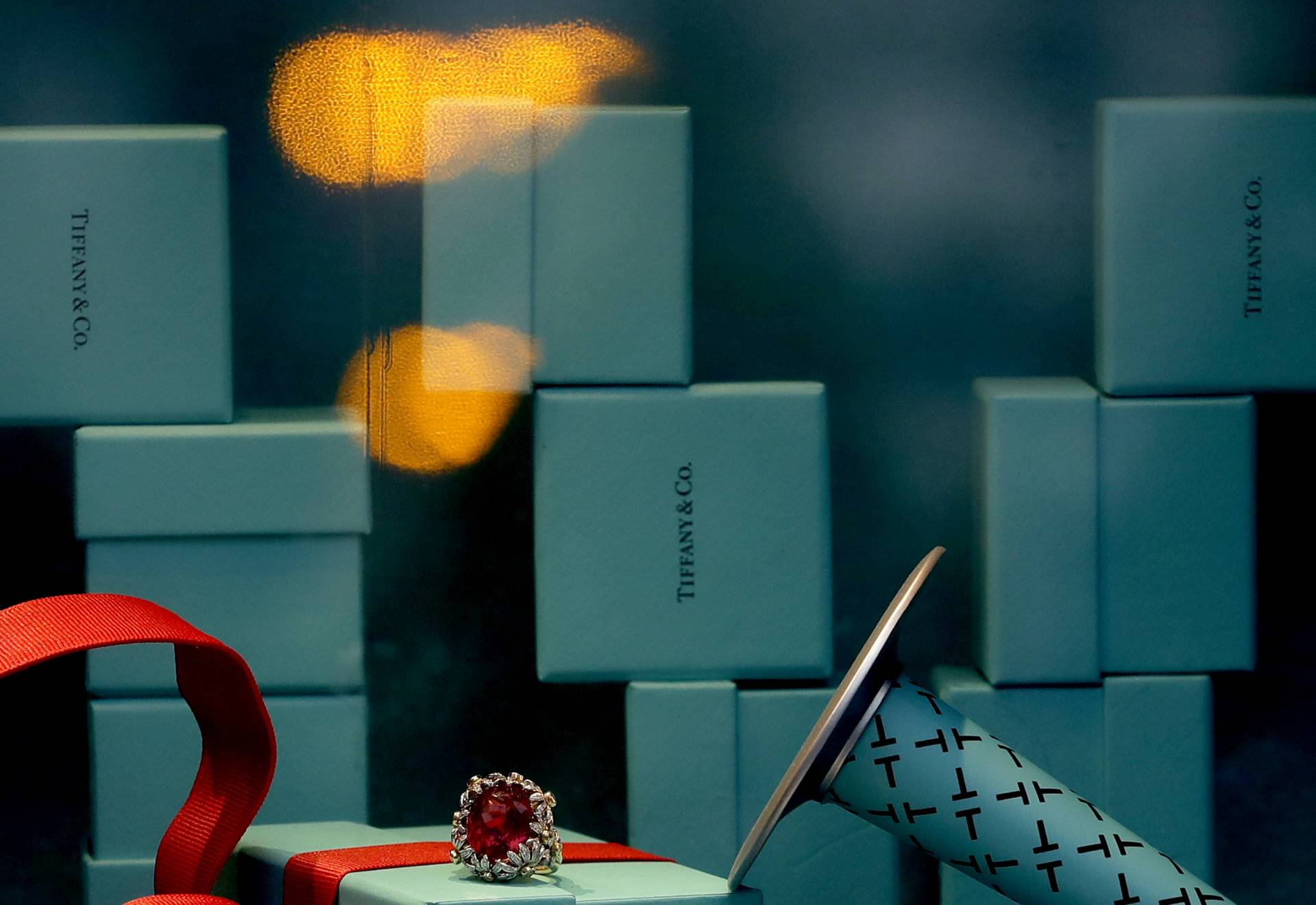 Lights are reflected in the shop window of Tiffany & Co. in London. Photo: AP