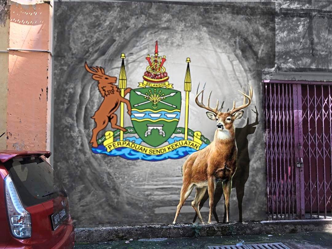 A mural of a deer adorning the wall of one of the back lanes in South Klang. — Filepic