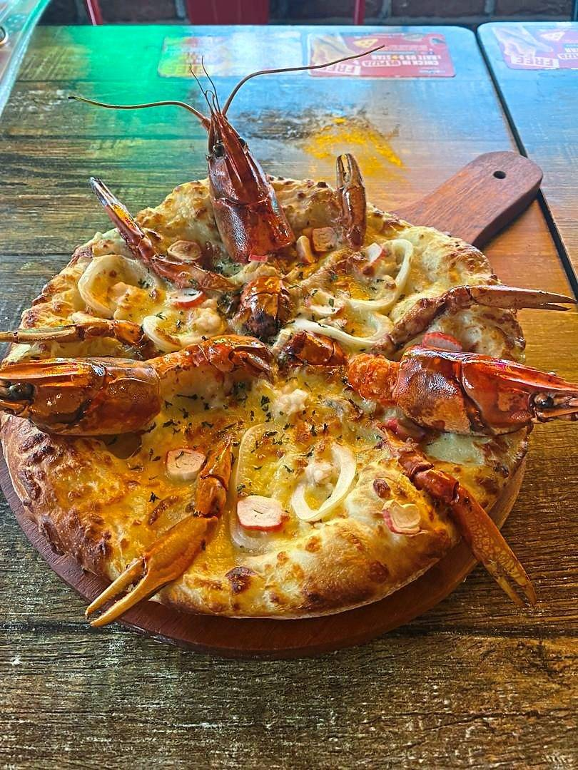 Cheesy lobster pizza to whet your appetite.