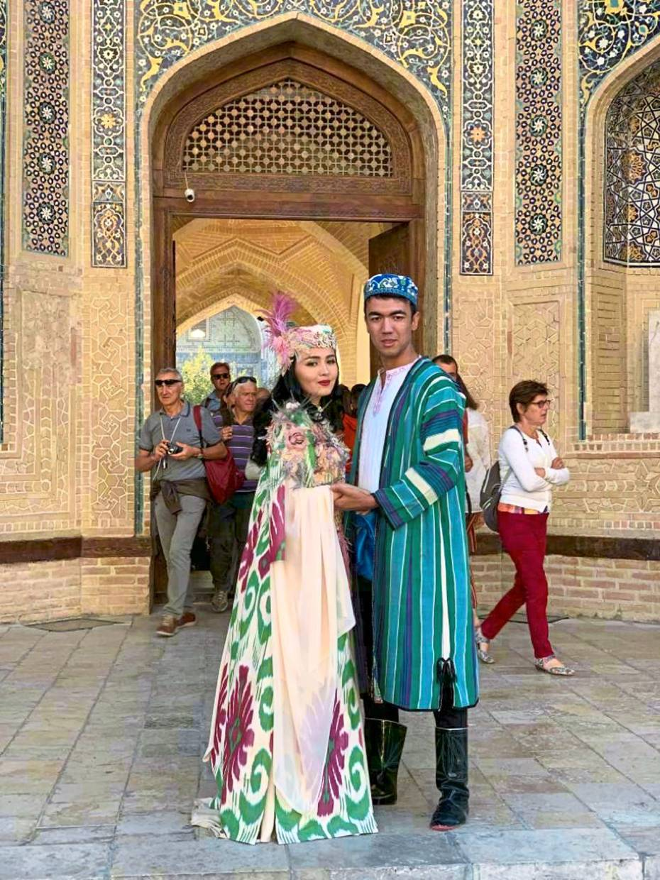 An Uzbekistan couple wearing their traditional costumes.