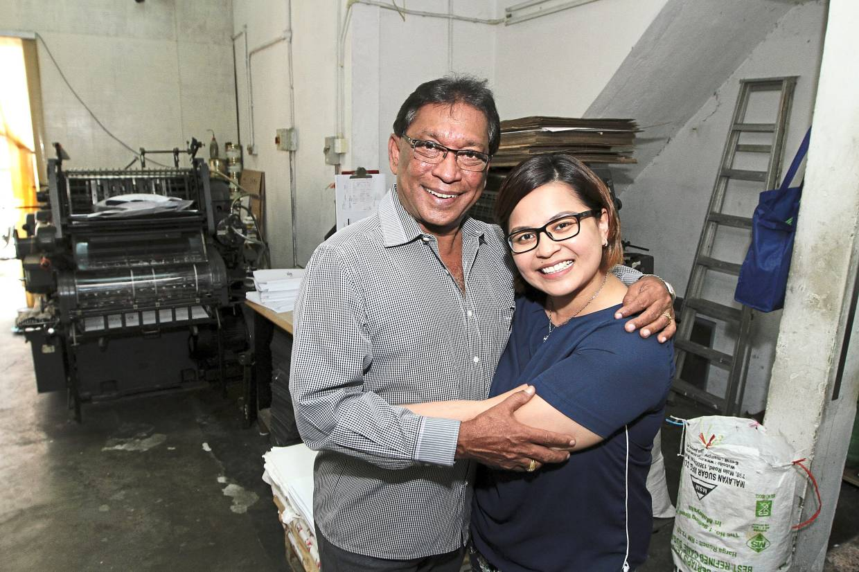 Irene's (right) prior work experience has proven to beuseful in assisting her father in the family business.