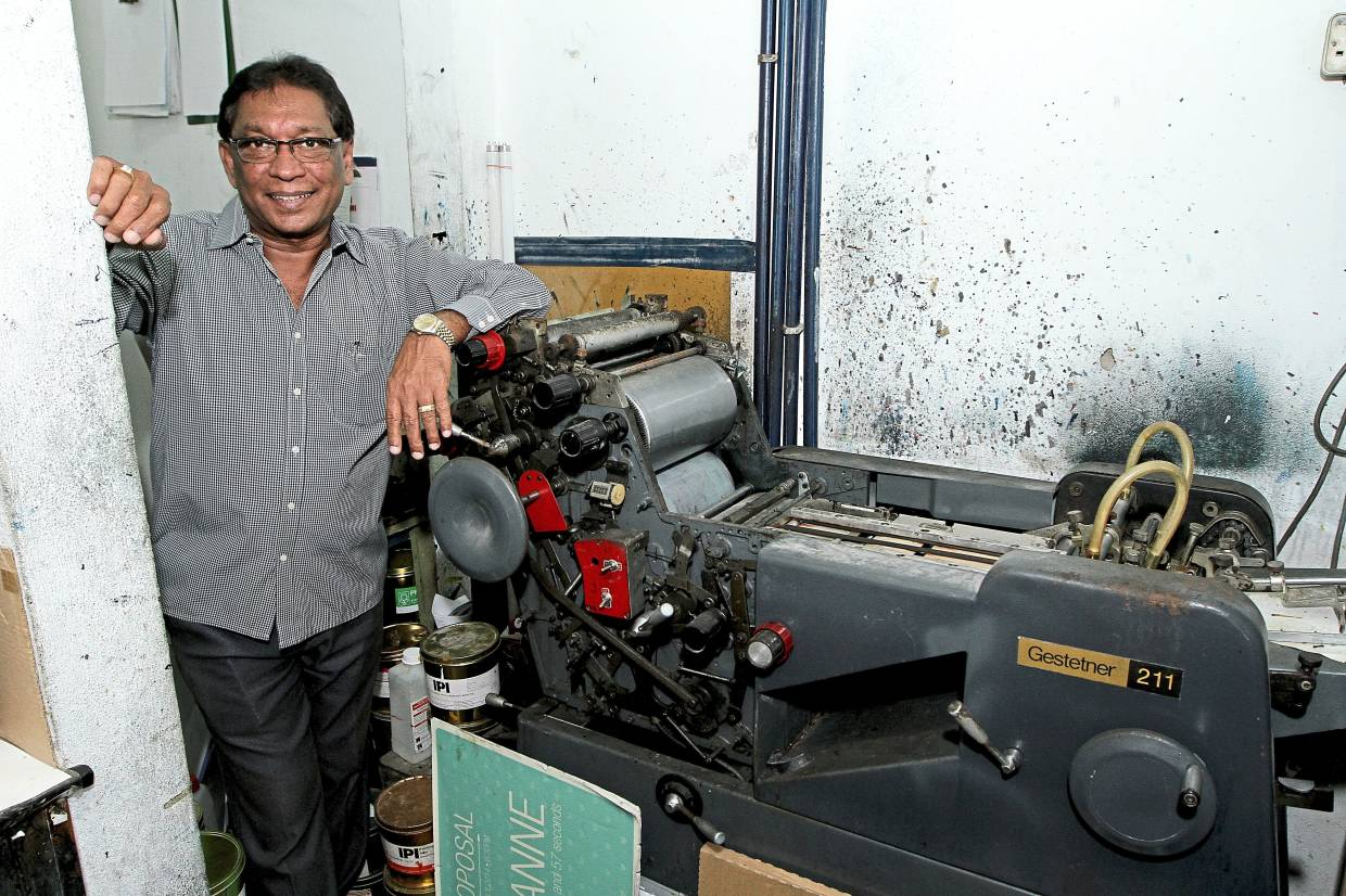 Gilbert Lewis bought his first offset printing machine with his savings for RM 9000 when he started his printing business in the late 1990s.