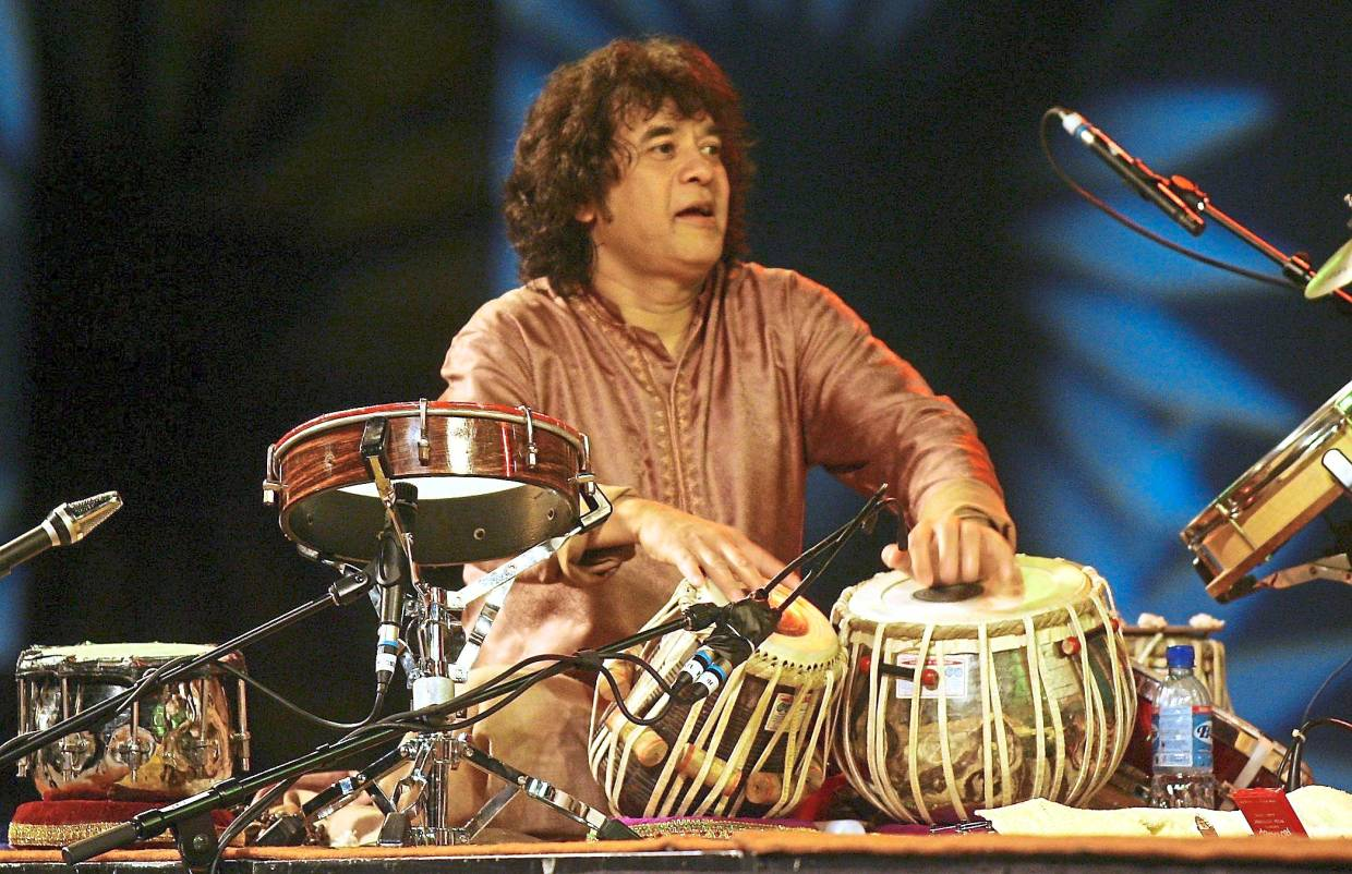 Legendary Indian percussionist Zakir Hussain returns to KL with world fusion group Shakti on Jan 17. Photo: Filepic
