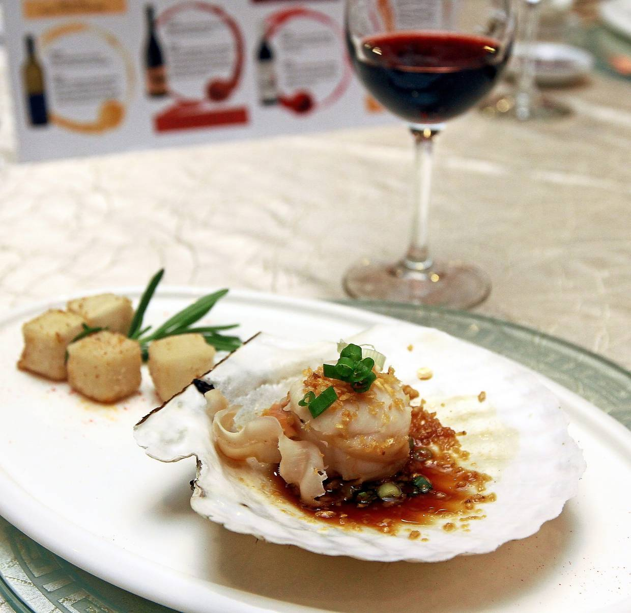 Steamed Air Flown Hokkaido Live Scallop with Royal Soya Sauce served with Fragrant Crusted Salted Beancurd.