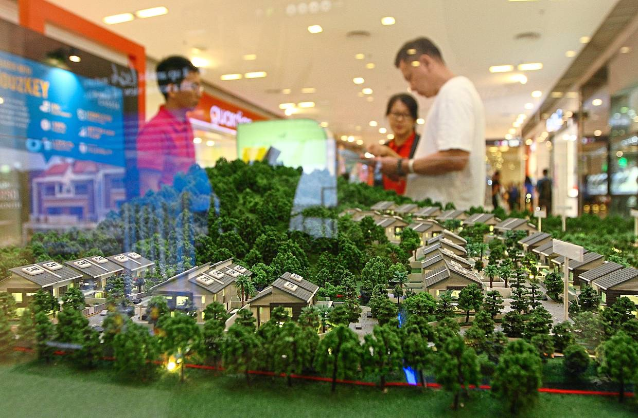 Foreign interests: People visiting a property fair in Penang. Malaysian properties have been getting interest from Hong Kong residents due to protests in the region which began about six months ago.