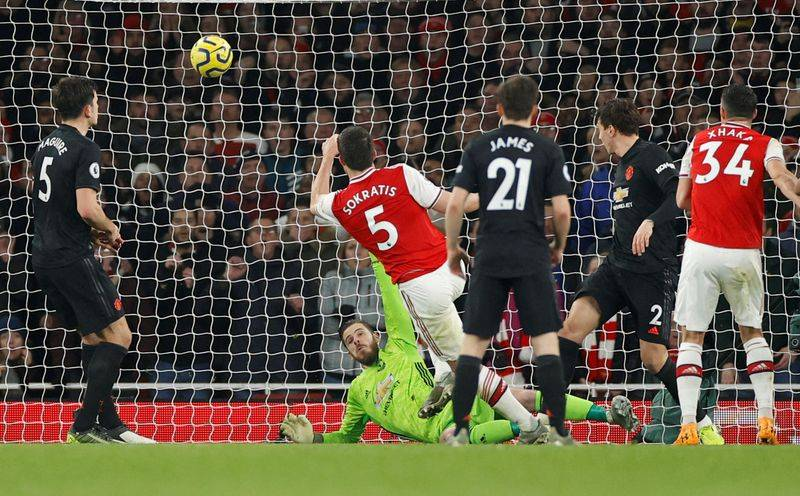 Soccer Football - Premier League - Arsenal v Manchester United - Emirates Stadium London Britain - January 1 2020   Arsenals Sokratis Papastathopoulos scores their second goal                 Action Images via ReutersJohn Sibley