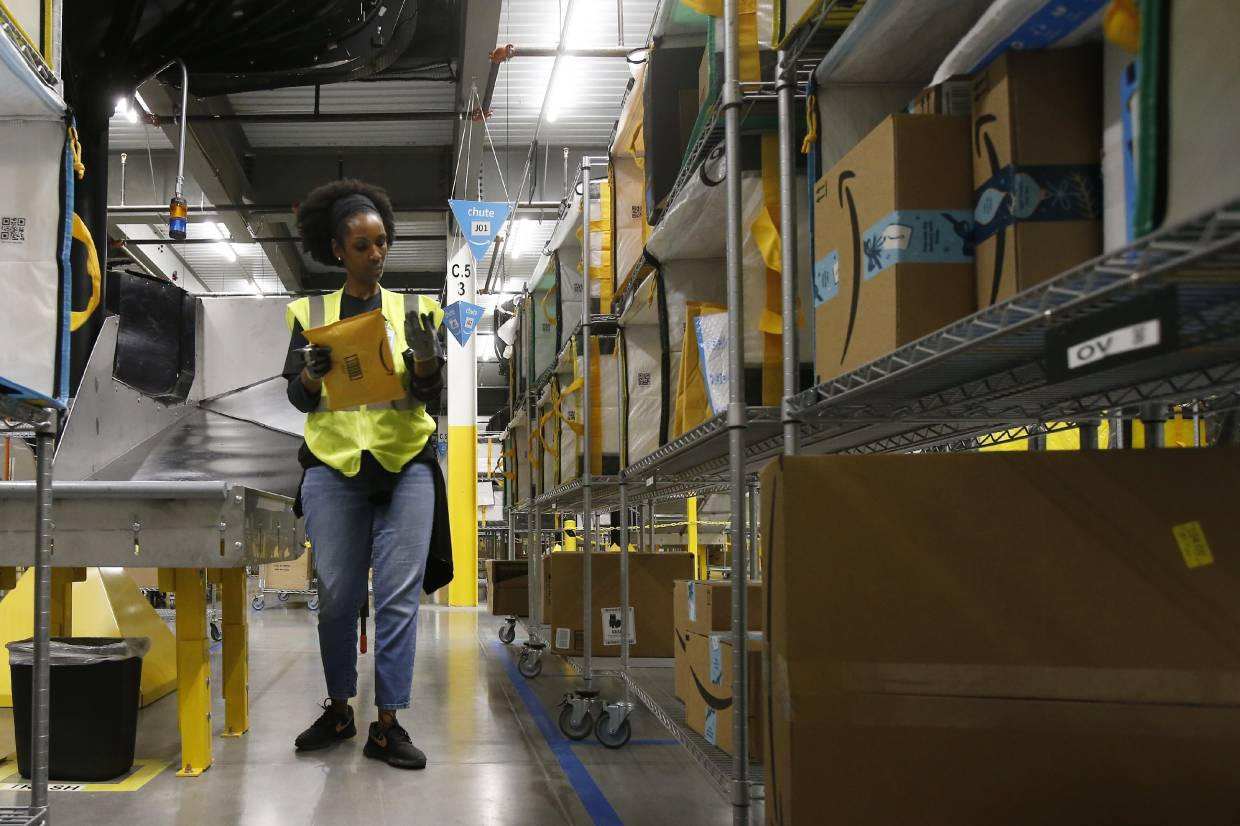 Amazon and its rivals are increasingly requiring warehouse employees to get used to working with robots. The company now has more than 200,000 robotic vehicles it calls 'drives' that are moving goods through its delivery-fulfillment centers around the US.