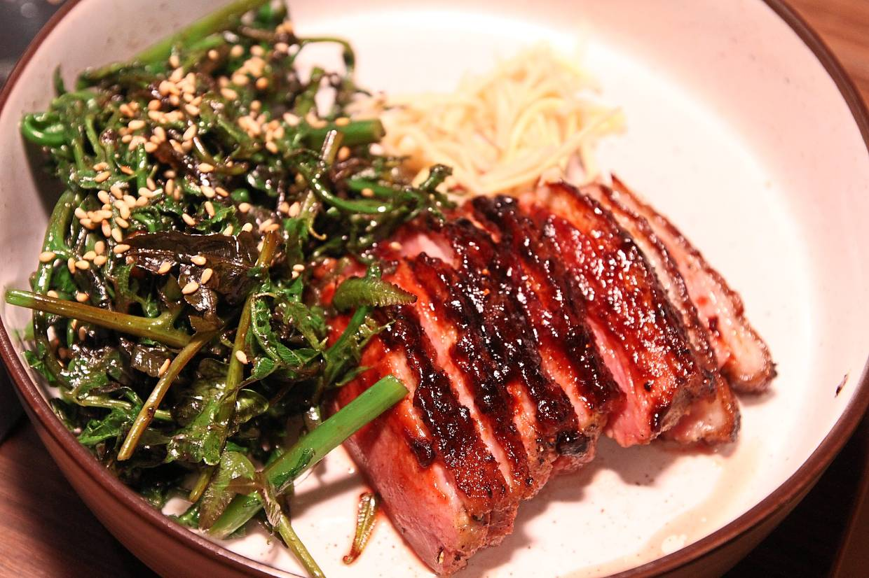 Dry-aged duck with kicap manis tare.
