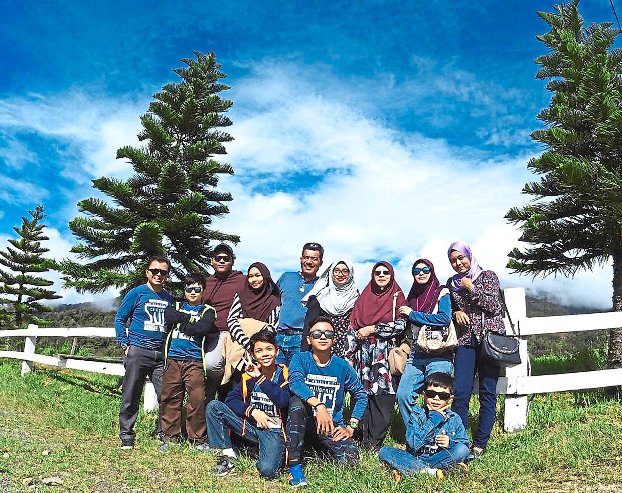 Nur Fatihah (standing, far right) travels with her extended family on a yearly basis. In 2018, the family travelled to Sabah for a short vacation. — NUR FATIHAH NOOR AZHAR SHAH