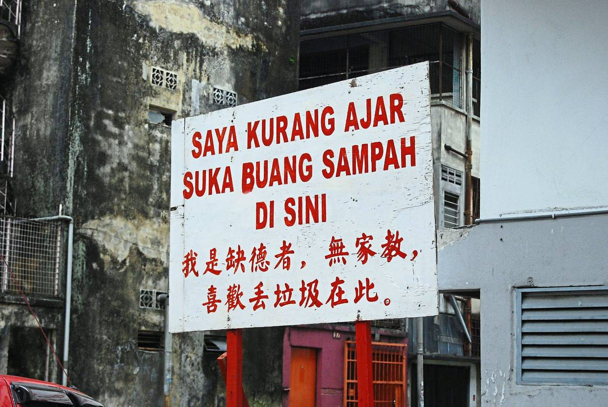 This sarcastic sign was put up by an angry business owner, who could not bear the rubbish-dumping near his premises anymore. People with Asperger Syndrome take what they hear or read literally, rendering them unable to understand sarcasm. — Filepic