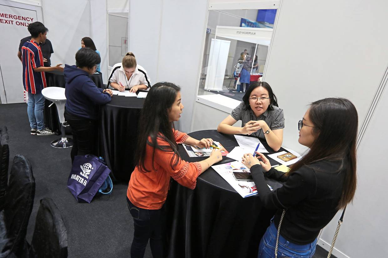Students take a career interest test at HELP University's CAREERsense@HELP during the Star Education Fair 2019 at the Kuala Lumpur Convention Centre last year.