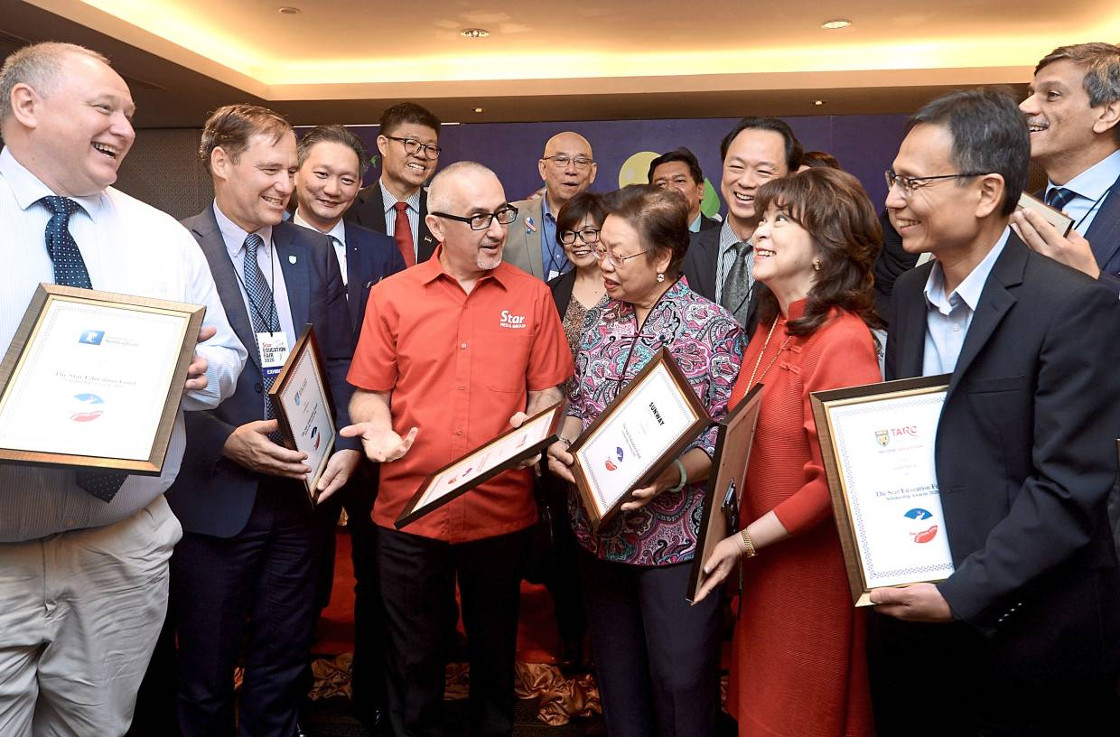 Working together: Vogiatzakis (third left) sharing a light moment with the Star Education Fund's partners-in-education, (from left) University of Nottingham Malaysia Campus provost and CEO Prof Graham Kendall, Royal College of Surgeons in Ireland and University College Dublin Malaysia (RUMC) president and CEO Prof David Whitford, Sunway College JB principal Hor Poh Choo, Sunway Education Group CEO Elizabeth Lee and Tunku Abdul Rahman University College president Prof Dr Lee Sze Wei.