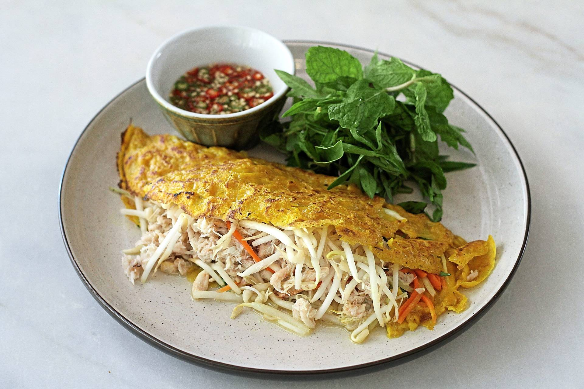 The crab banh xeo is a revelatory affair bound to delight from the very first bite.