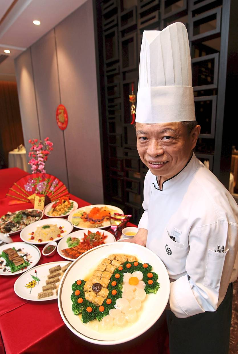 Lim with some of the dishes from Yue Chinese restaurant's festive menu. — Photos: KAMARUL ARIFFIN/The Star