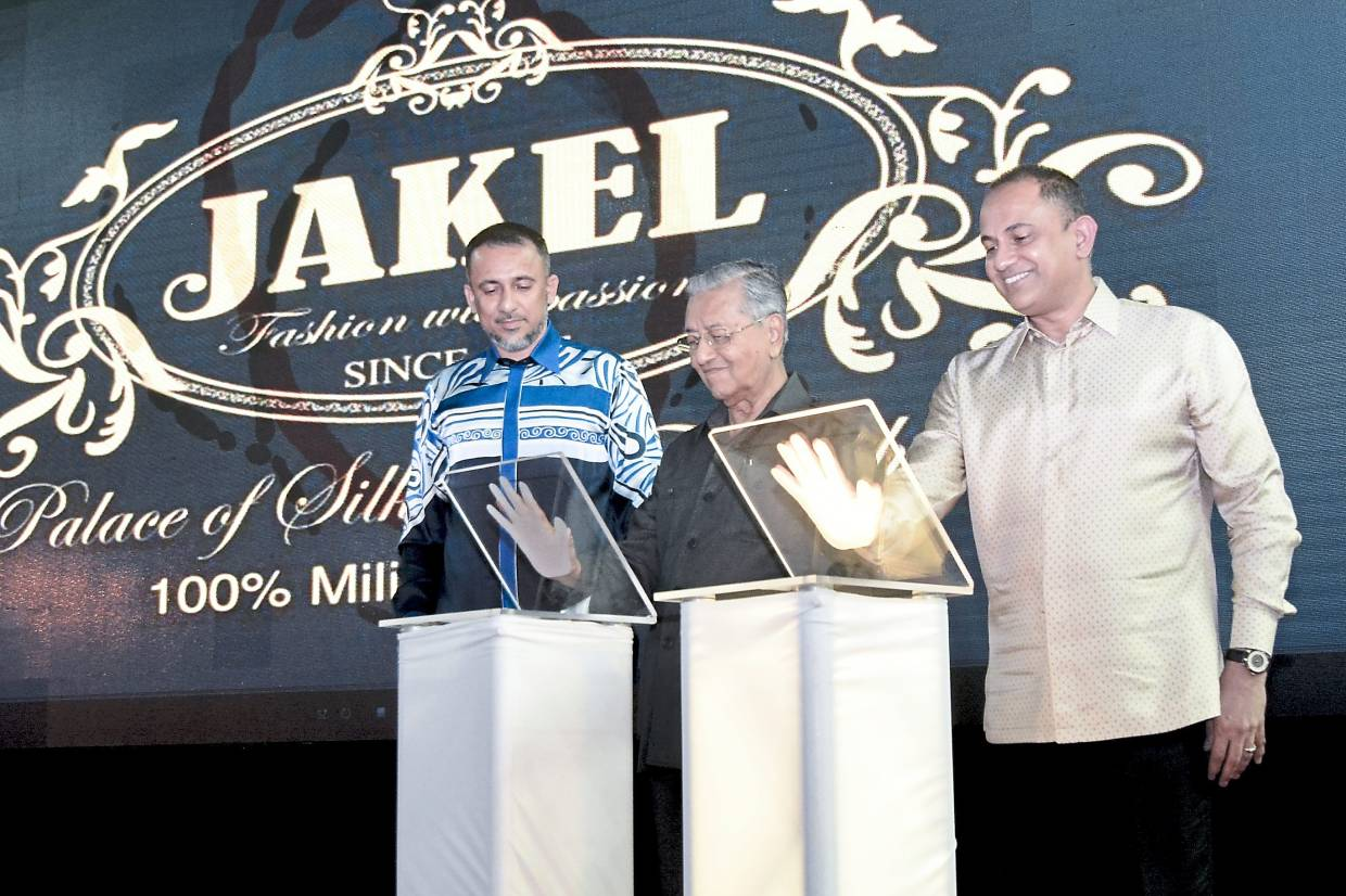 Great start: Prime Minister Tun Dr Mahathir Mohamad officiated Jakel Langkawi on Dec 8 last year, with Mohamed Faroz (right). Also present was Jakel Chief Operating Officer Datuk Mohamed Nizam Mohamed Jakel (left).
