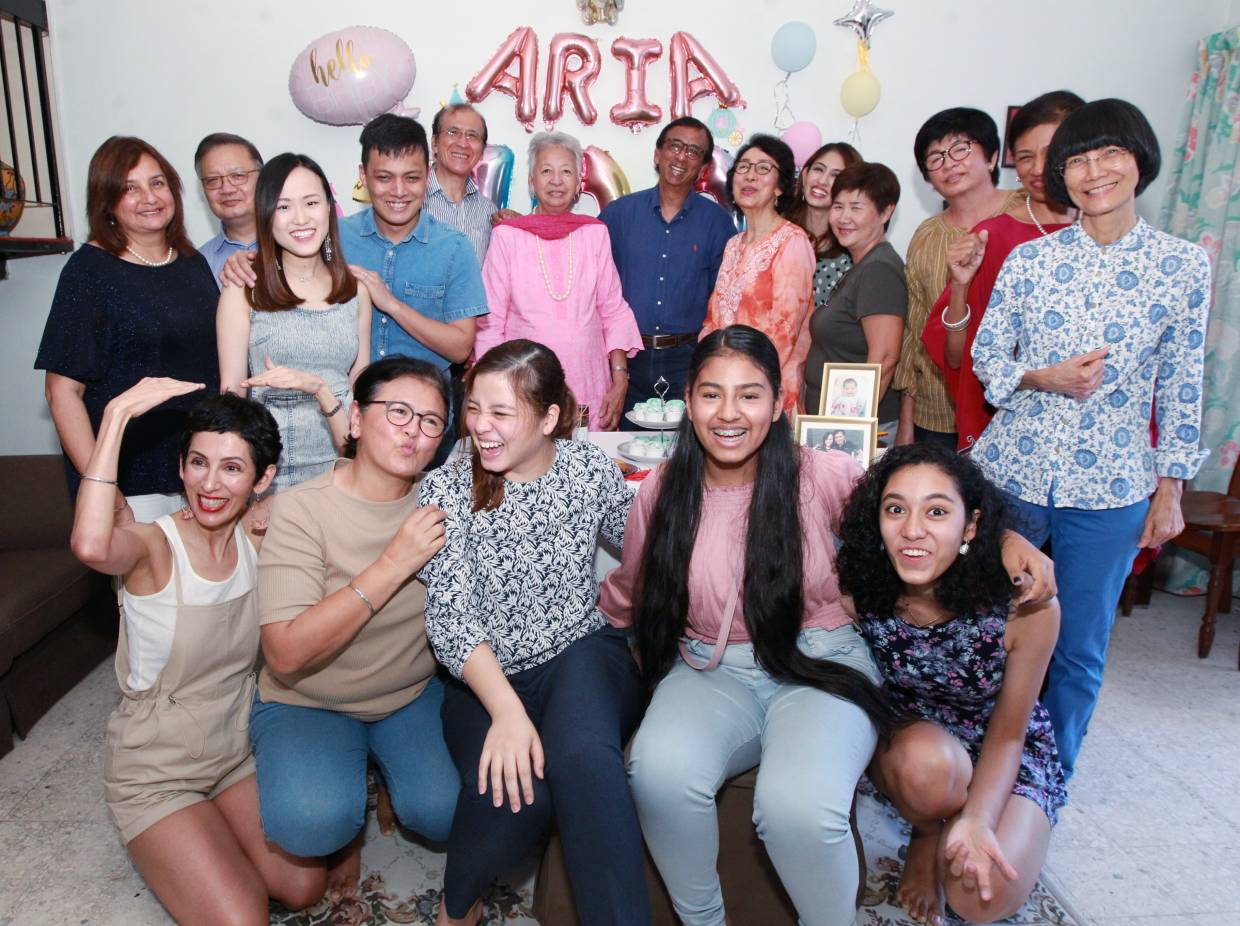 Seven of the siblings and their families got together at their sister Kulwant's (front, second from left) house in Ampang, Selangor, recently for her granddaughter's 100-day celebration.