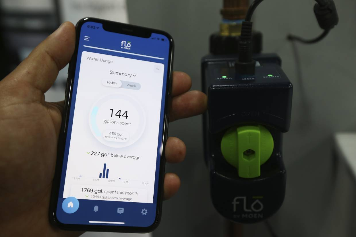 Monitors from Flo Technologies connect to homes' water lines and track usage. — AFP
