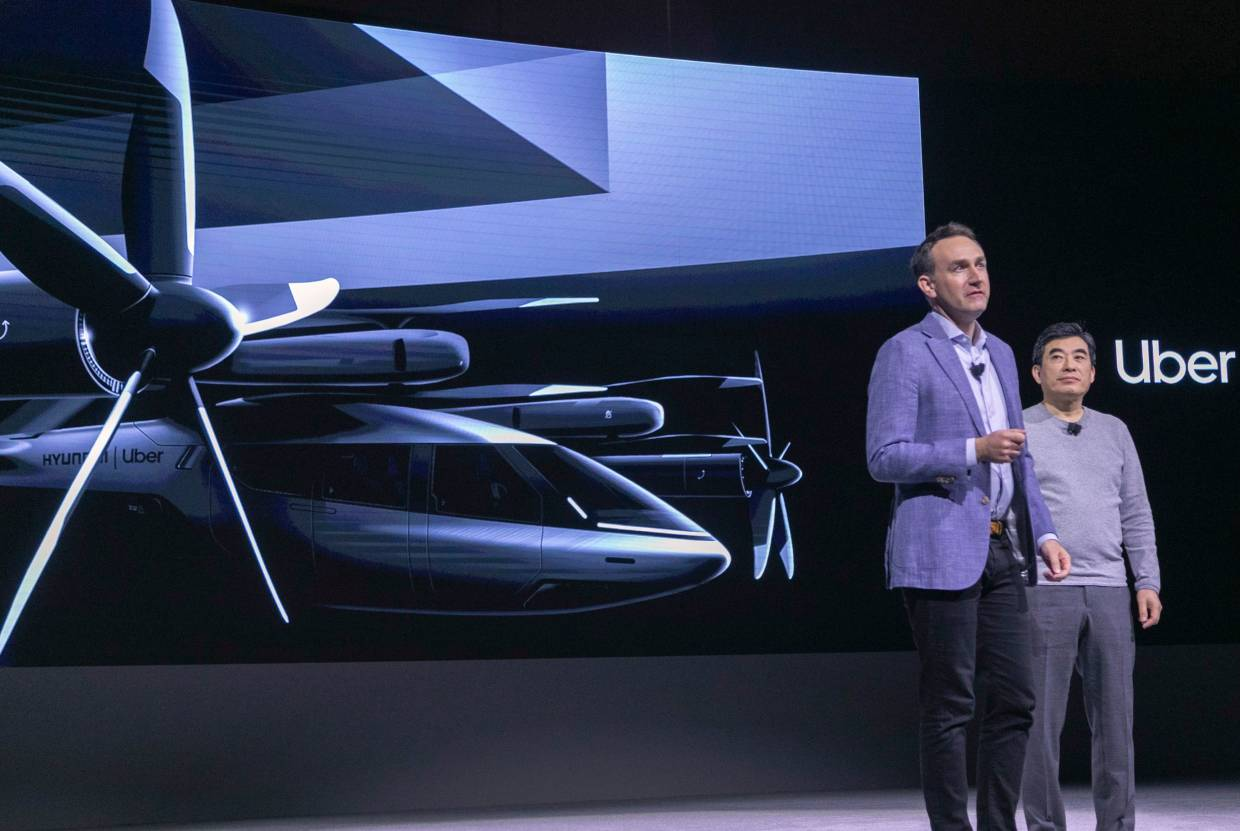 Uber Elevate head Eric Allison (left), and Hyundai Urban Air Mobility head Jaiwon Shin talking about the S-A1 electric vertical takeoff and landing (eVTOL) aircraft at the event where Hyundai announced its partnership with Uber to create an air taxi network at CES. — AFP