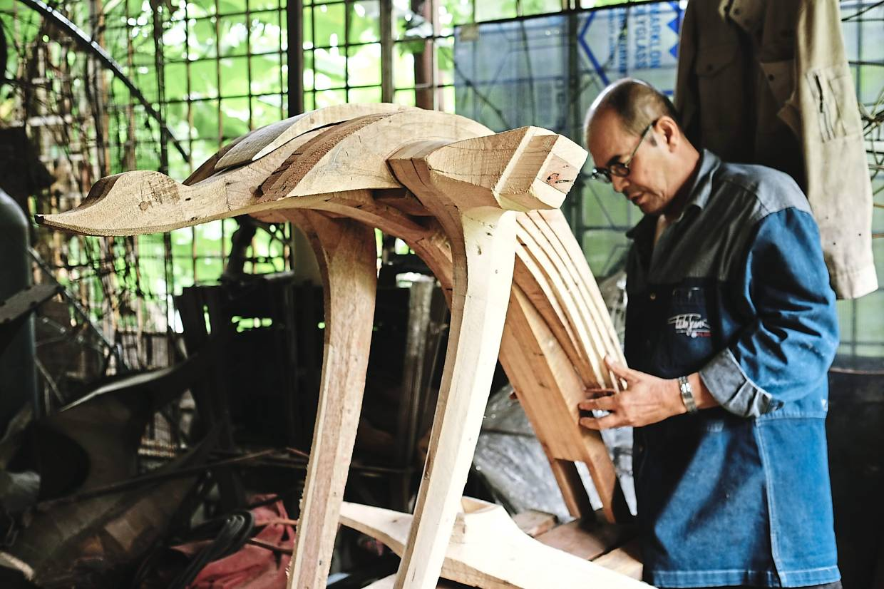 Mad Anuar is a sculptor who works primarily with wood and metal, creating large-scale, 3D artworks inspired by Malay folklore and traditional motifs. Photo: Fauzi Tahir