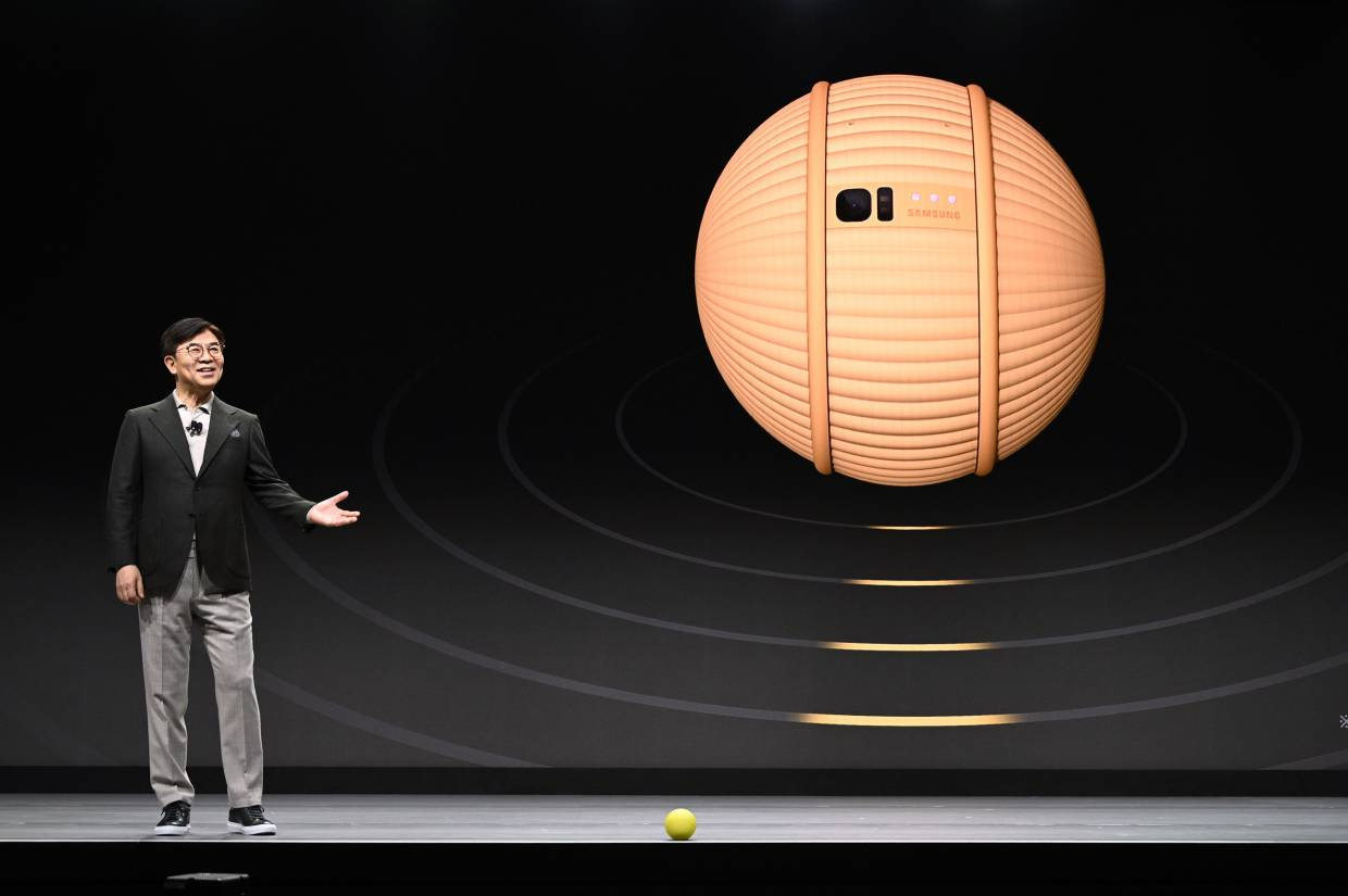 Kim introducing Ballie, a round yellow life companion robot that can react and interact with its owner, during his keynote address at the 2020 CES in Las Vegas, Nevada. — AFP