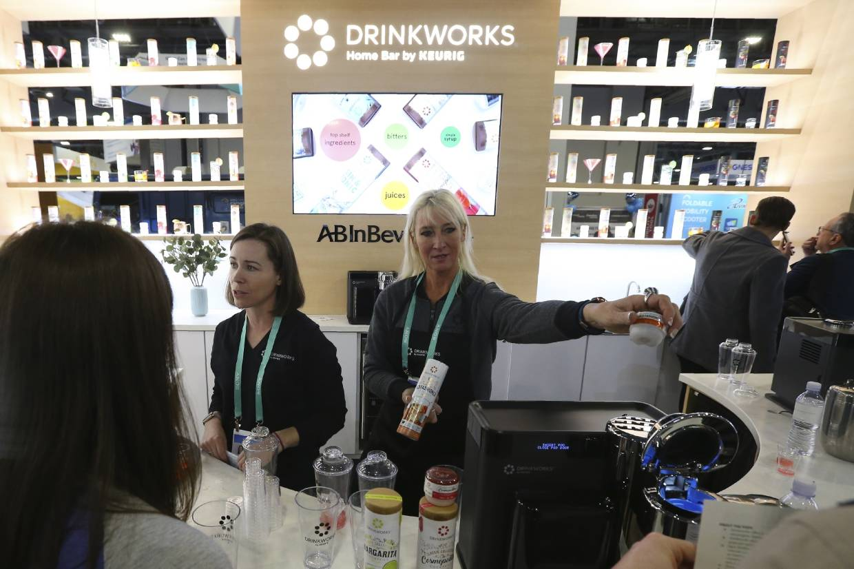 Drinkworks Home Baby Keurig drink making machine demonstrated to customers at the company's booth where the machine makes cocktails, ciders and brews during the CES tech show in Las Vegas. — AP