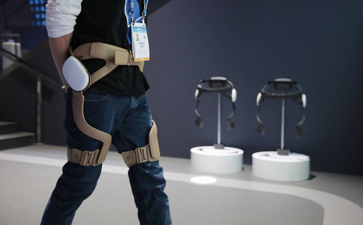 A man demonstrating GEMS in the Samsung booth at the CES tech show. The exoskeleton device can assist your walking and help correct your posture. — AP