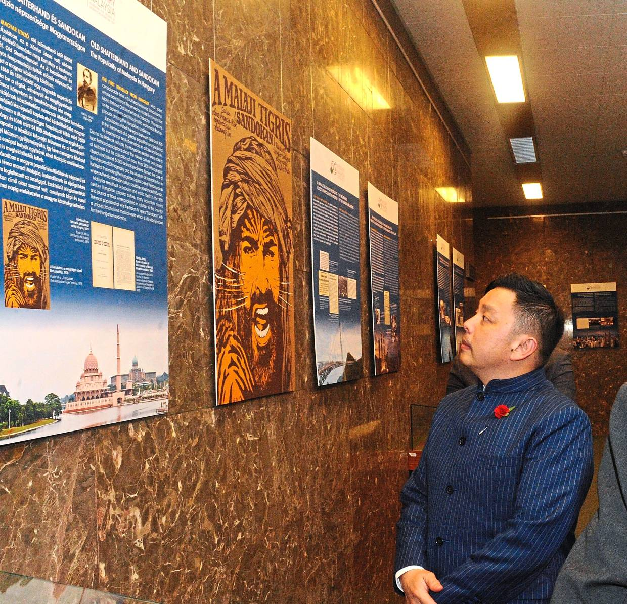 Datuk Darell Leiking is drawn to the poster of the Tiger of Malaysia at the exhibition in Budapest, Hungary, on Nov 15, 2019.
